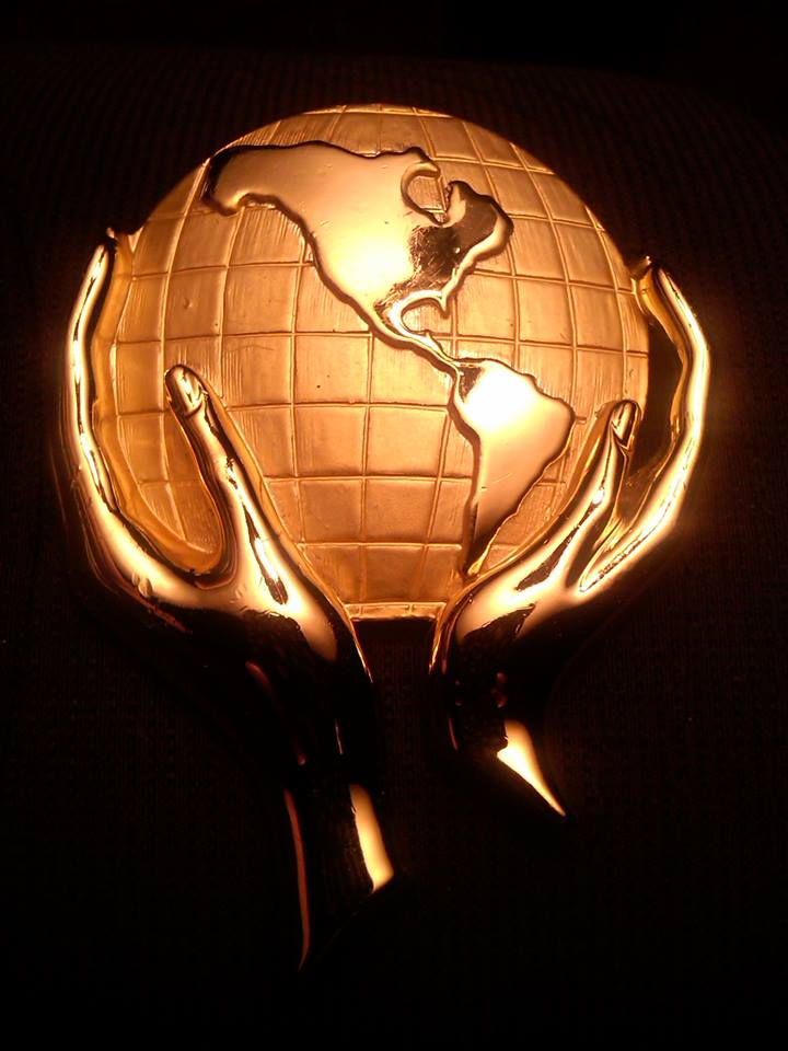 healing-the-earth-and-the-inhabitants-therein-gold-hands-holding-earth-globe-planet-ug-2